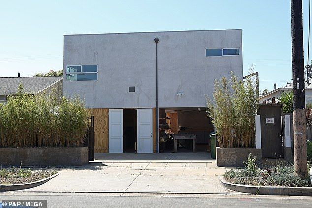 Fortress Robbie: The home's façade is covered in industrial grey concrete and has barely any windows - making the building appear more like a fortress than a family home