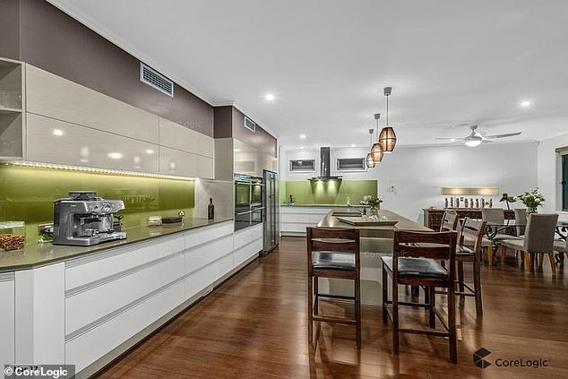 Mod-cons: The property features a double garage, hardwood floors throughout, a pool and a wine cellar beneath the stairs