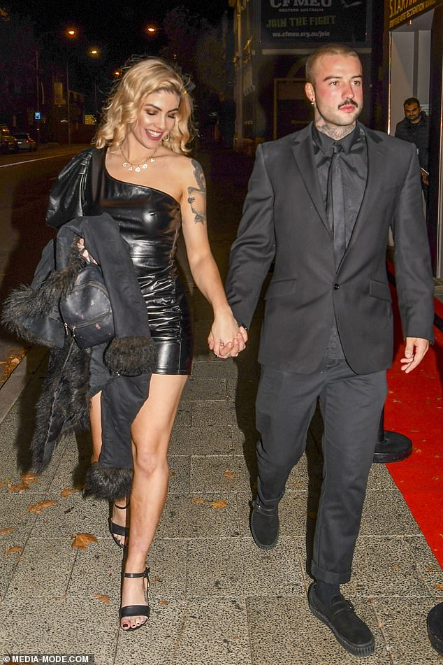 New romance? Married At First Sight's Booka Nile may have finally found her Mr Right after she was spotted holding hands with tattooed musician Corey Freear in Perth on Tuesday