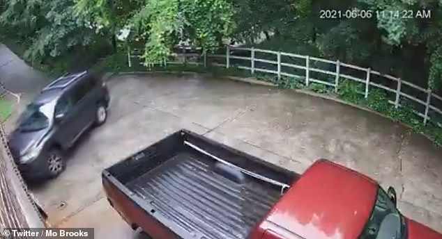 In the video, an SUV - which Martha is thought to be inside - is seen coming up the driveway and driving into the open garage of their home