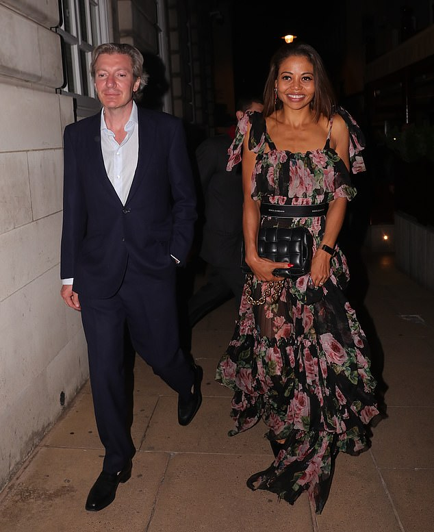 Outing: Emma Weymouth put on a stylish display in a black floral gown for a romantic date with husband Ceawlin Thynn to celebrate their eight year wedding anniversary on Wednesday