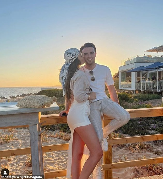 Forever: Natalya has flown on holiday with her boyfriend Tommy and they posed for a picture in the beautiful sunlight of golden hour by the beach