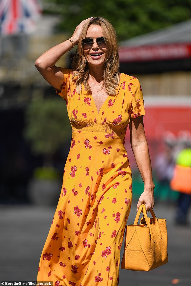 Incredible:The presenter, 50, was a vision in the patterned midi dress as she confidently strutted her stuff along the pavement to head home