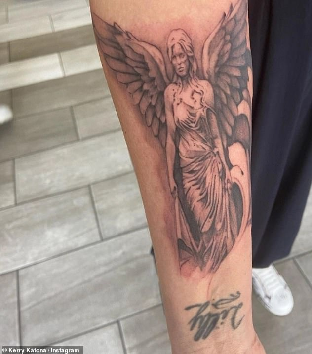 Guardian angel:Kerry was back in the parlour to finish working on a tattoo she started last month - a giant angel stretching from her wrist to her elbow
