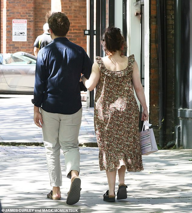 Stroll: Helena took Rye's arm as they ambled through the streets