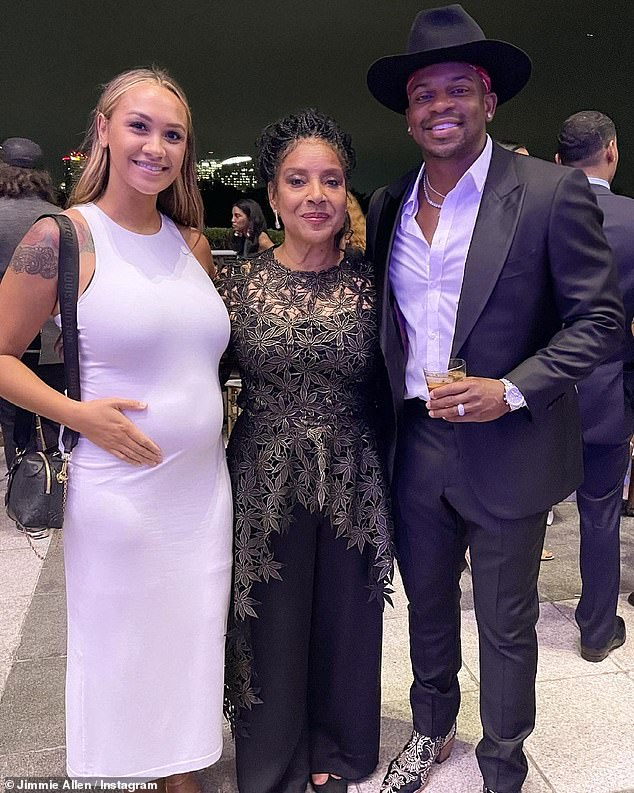 Bumping along: In another photo shared to Jimmie's Instagram, the pair posed withRashad (The Cosby Show) as Alexis accentuated her bump in a white dress