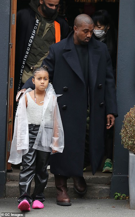 Daddy duty: Kanye has four children with estranged wife Kim (pictured with seven-year-old daughter North in 2020)