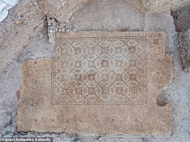 The artifact is aa colorful mosaic carpet ornamented with geometric motifs