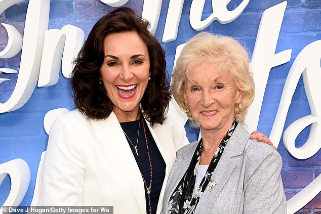Lovely:The dancer looked fabulous in a sharp white blazer and showstopping red heels as she posed for snaps with her beloved mother Audrey