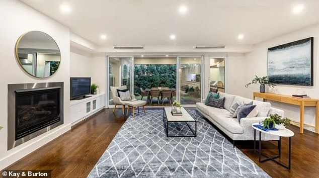 Glamorous: Advertised as 'low-maintenance luxury living', Dannii's new home boasts a private lift, cellar