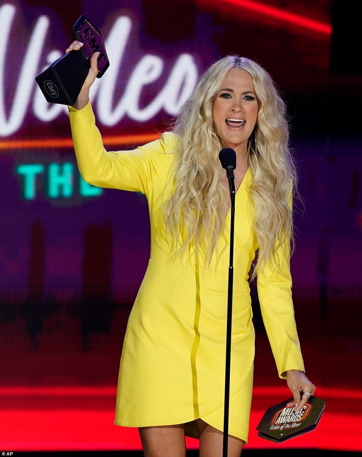 Winner: 'Congratulations on what I think is your first CMT award!' she shouted out to Legend, before saying the 'behind-the-scenes conditions' leading up to the video had been 'so awkward'