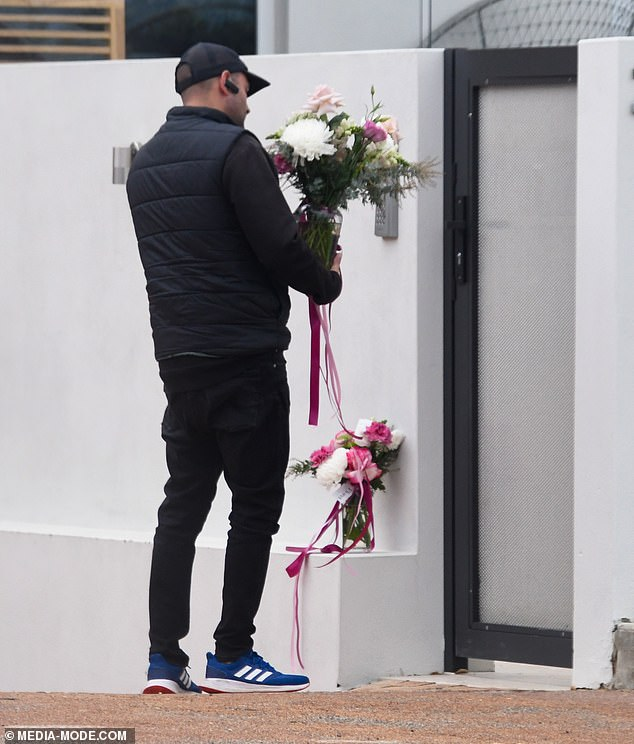Fondness: A delivery man was seen putting flowers at Kate's gate after the actress revealed she would be leaving Australia