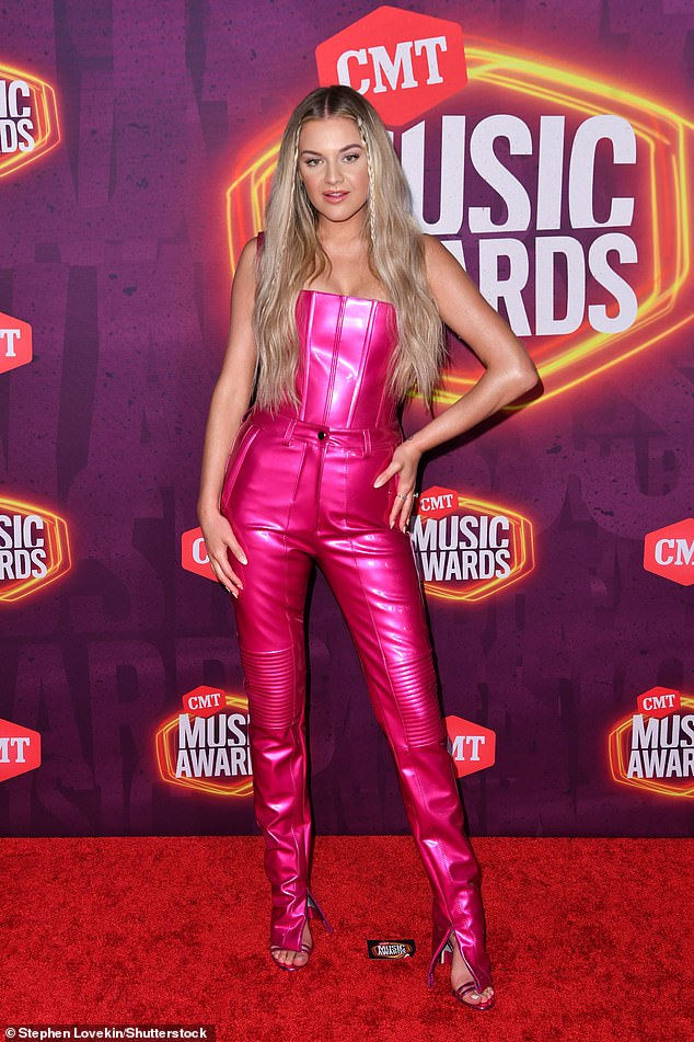 Red carpet:Before the show's commencement, Ballerini wowed in a hot pink vinyl ensemble complete with a corset top and tight trousers to match