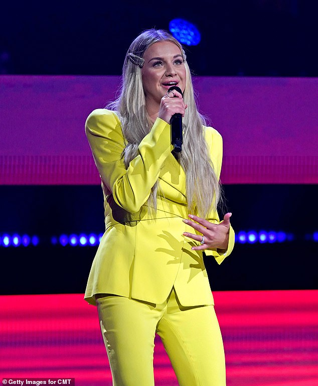 Bright:She reappeared in a bright yellow pantsuit complete with a pair of retro flared trousers and a tailored blazer