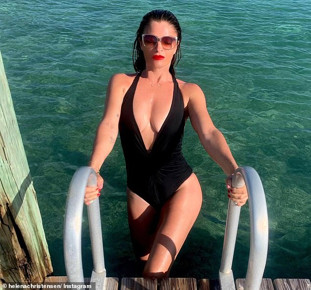 Flawless:The Danish beauty added a touch of glamour with a statement red lip and kept her long brunette tresses in a slicked-back style