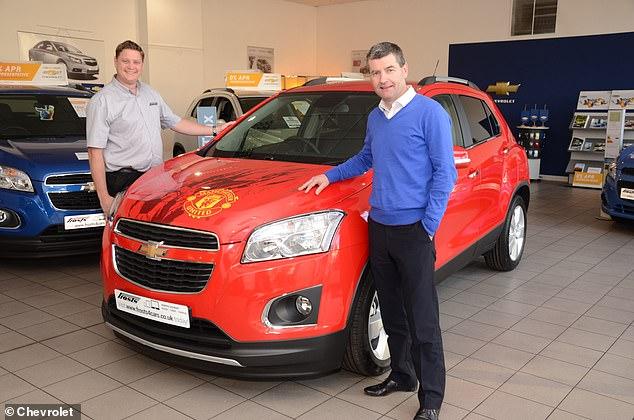 Former Manchester United and Republic of Ireland left-back Denis Irwin poses with a Chevrlet Trax donated to a West Sussex dealership to be used to raise money for charity