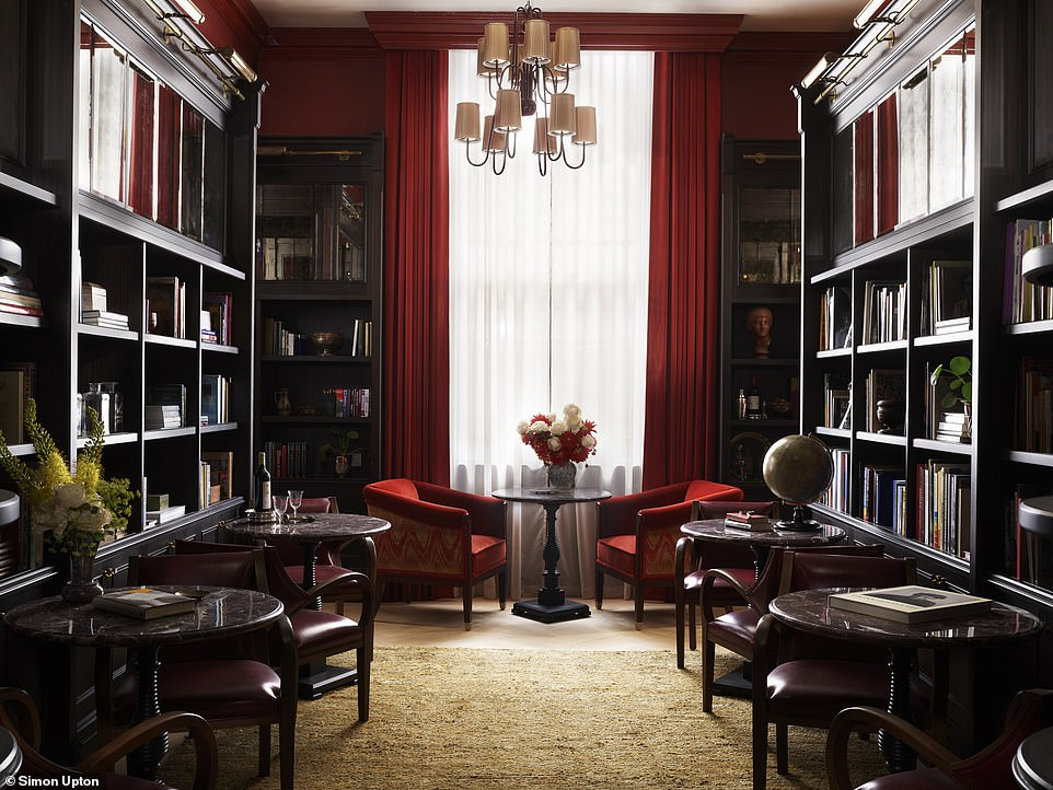 The hotel-guest-only Library, where drinks are sipped on red velvet sofas and armchairs