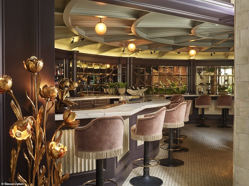 The plush marble-topped bar area off the NoMad's conservatory-styled main restaurant