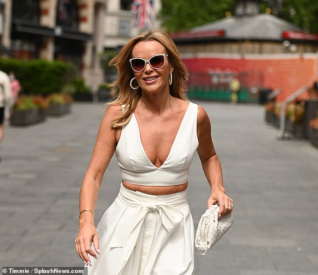 Top of the crops:Amanda looked sensational in the cleavage-baring crop top which also showcased her tiny waist
