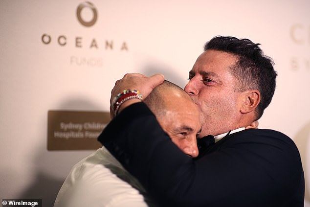 Very friendly! Karl Stefanovic gave famed chef Guillaume Brahimi a spirited kiss on the head as they attended the Gold Dinner 2021 in Sydney on Thursday