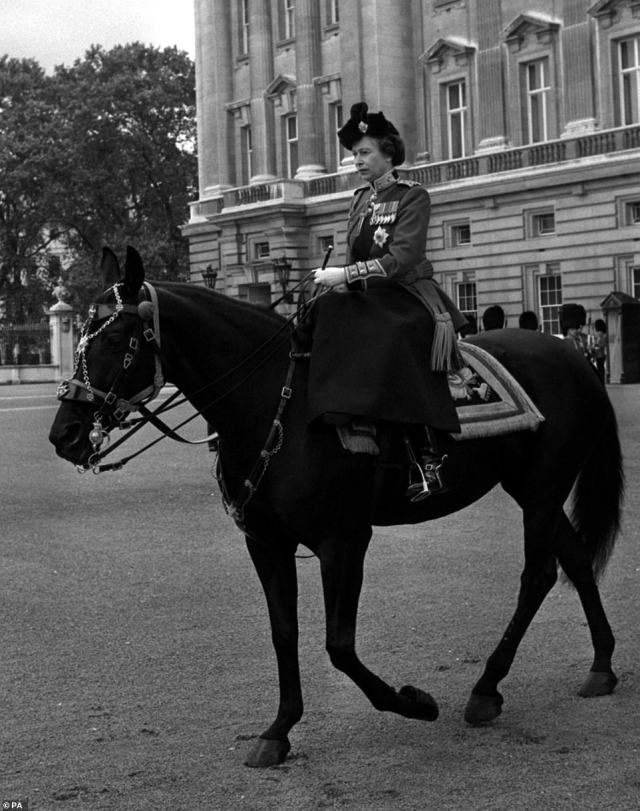 1979 — HER MAJESTY AND BURMESE:The Queen rides her horse Burmese while leaving Buckingham Palace for Horse Guards Parade and the Trooping the Colour ceremony in celebration of her official birthday in 1979.