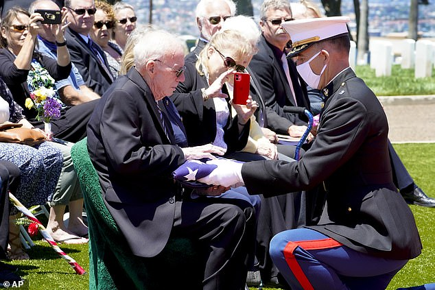 Lt. Col. Christopher Benson, right, presents the flag that covered U.S. Marine Corps, Pfc. John Franklin Middleswart casket, to his nephew Edward Brown during the full military honors ceremony at Fort Rosecrans National Cemetery Tuesday, June 8, 2021, in San Diego