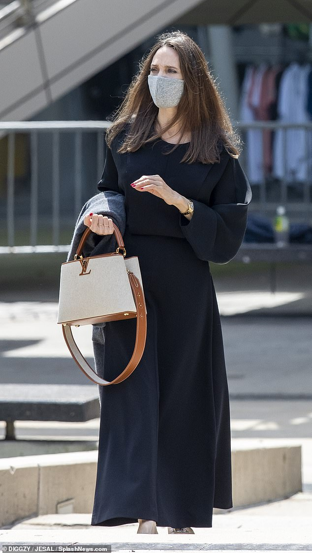 Seeing the sights: Angelina dressed conservatively in a long black dress for a three-hour private guided tour through the gallery in New York amid bitter custody battle with ex Brad Pitt