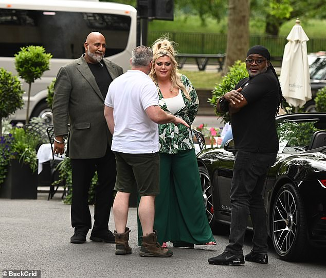 Catch-up:He was seen wearing khaki shorts and a white top as he chatted with Gemma and her associates outside