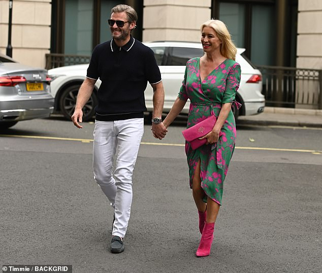 Designer accessories:The former Big Breakfast presenter, 47, proved she has expensive taste as she held a pink clutchbag from Mulberry