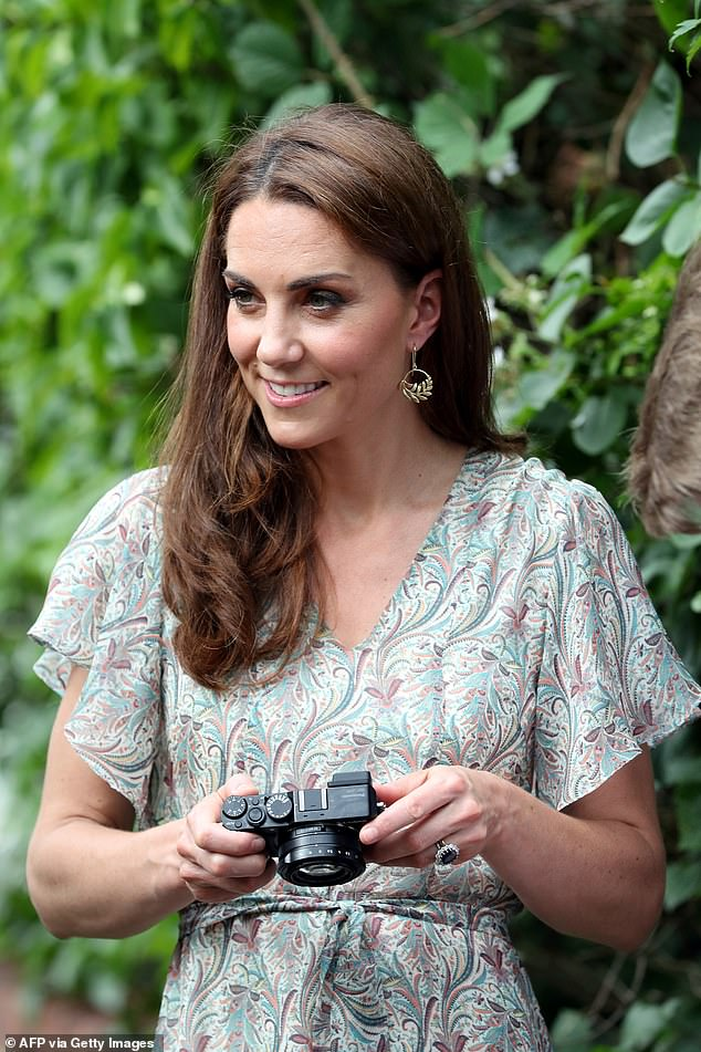 The Duchess of Cambridge (pictured) has revealed how her children are sometimes reluctant to be picked up by their mother during a phone call to a finalist in the Hold Still photography competition