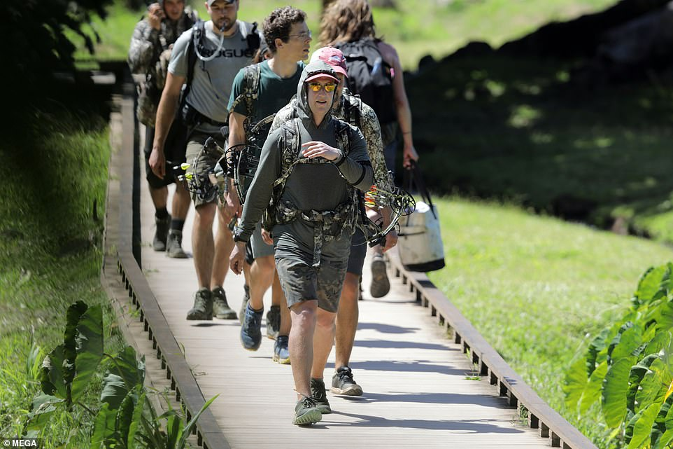 One woman who walked past them as they ventured towards the trail was carrying a tote bag instead of a hunting backpack with weapons