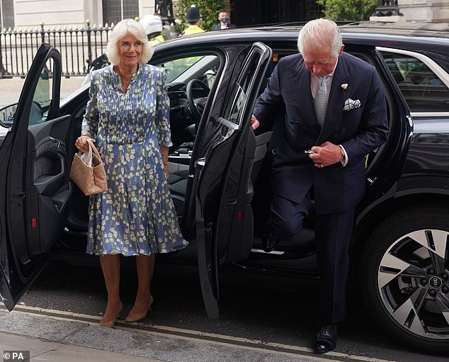 The Duchess of Cornwall (pictured arriving with her husband), who wore her blonde hair coiffured away from her face, kept her makeup minimal and opted for a fine layering of mascara
