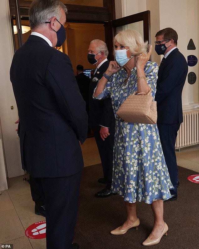 Camilla (pictured) looked effortlessly elegant for her outing with her husband in a floral silk, blue frock, embellished with white flowers.