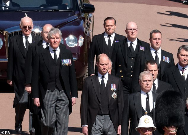 The Duke of Edinburgh¿s closest aides were honoured by the Queen yesterday on what would have been his 100th birthday