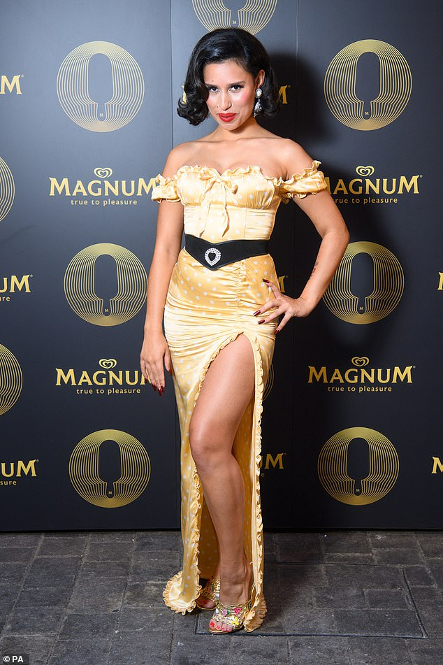 Belle of the ball: Raye exuded glamour in a showstopper gold gown on Thursday as she debuted her new single, Call On Me, at Magnum's #ShowYourLayers campaign event in London