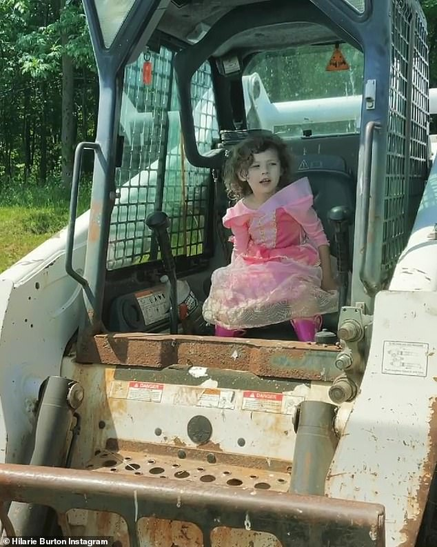 Working girl:'Morgan girls WORK,' Burton said in the caption of her post, while adding the hashtag #TrainThemYoung and tagging @BobcatCompany and @TheMischiefFarm
