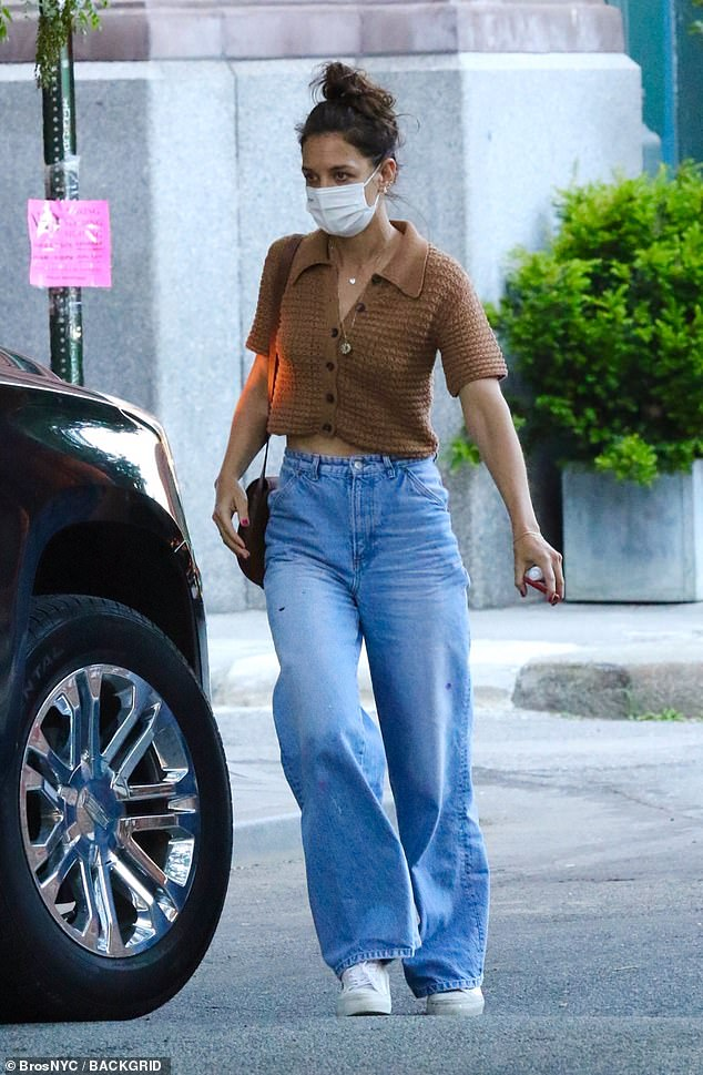 Causal: Katie Holmes showcased her chic sense of style in a knitted crop top and a pair of light-wash jeans while grabbing dinner with her father Martin in New York City
