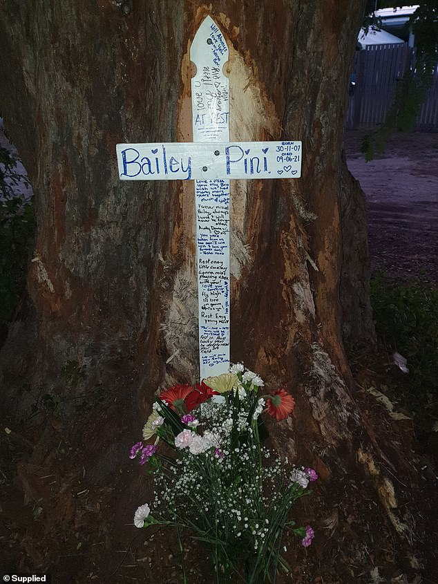 Bailey Pini is believed to have stolen the car from Sarina around 4am on Wednesday but crashed into a tree in nearby Bowen around 6.45am. His family placed a cross at the scene yesterday (pictured)