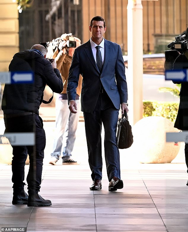 Mr Roberts-Smith served six operational tours in Afghanistan with the elite Special Air Service and left the regular army in 2013 with the rank of corporal. He is pictured arriving at court on Friday