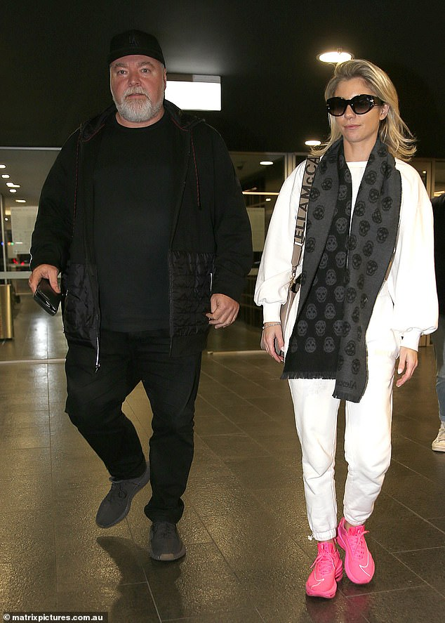 Gone shopping! Kyle Sandilands (pictured with his girlfriend, Tegan Kynaston) picked up an expensive gift at the Bondi Junction shopping centre in Sydneyon Thursday