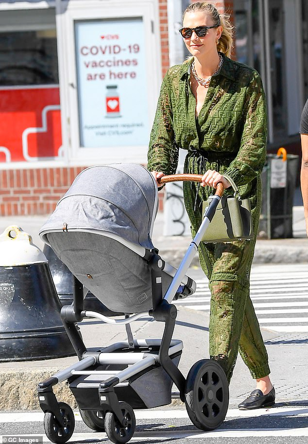 Baby Mine: Earlier that same day, Karlie could be seen in New York pushing a stroller containing her baby that she welcomed into the world on March 11
