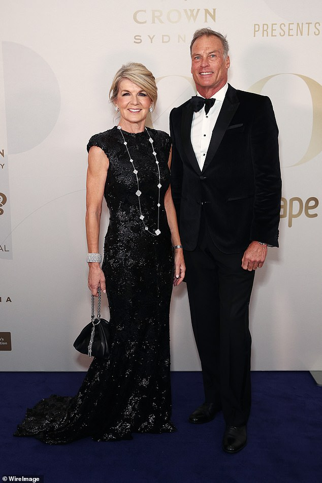 Expensive taste: Julie Bishop spared no expense when she dressed up for the Gold Dinner in Sydney on Thursday. Pictured with boyfriendDavid Panton