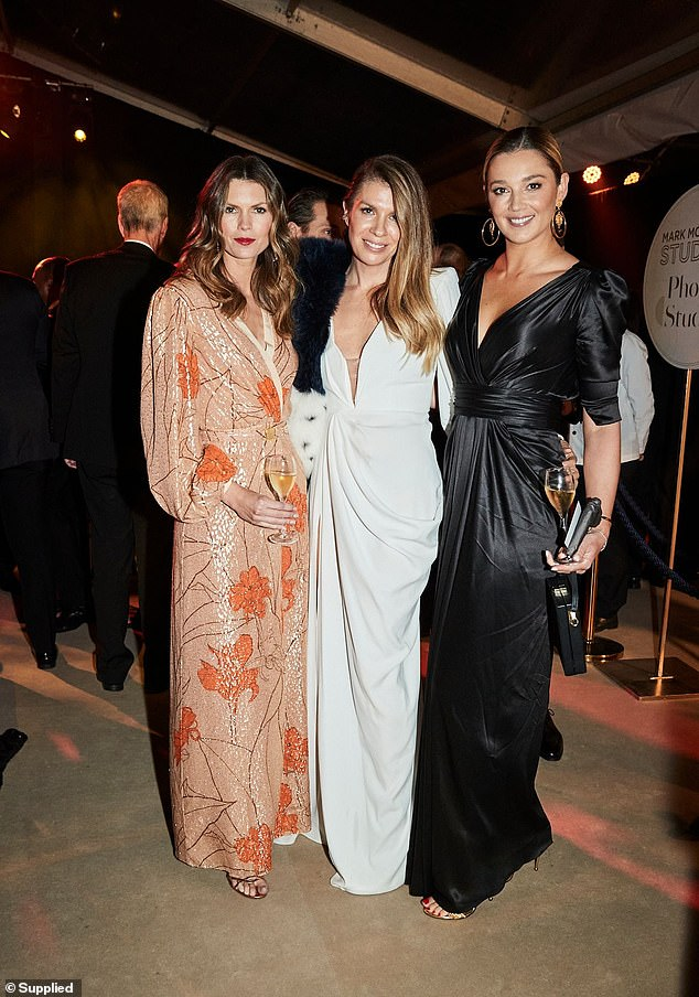 Glamour: Jasmine Stefanovic, 37, channelled Old Hollywood glam in a plunging black gown as she poseed up a storm at the this year's Gold Dinner held at Sydney Airport on Thursday. Here with palsAnnalise Scarf and Emma van Haandel