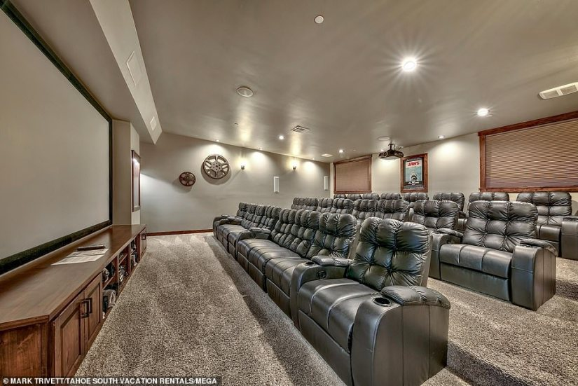 Movie night: A luxe home theater on the property comes with leather chairs and seats 25 people comfortably
