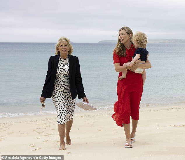 RAISED CHIN, CONFIDENT SMILE: Carrie tilted her head upwards and looked confident and in control, Judi noted, even as she strode onto the sand with Jill Biden