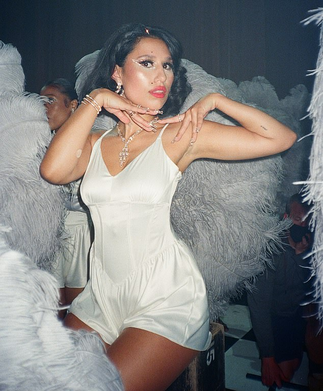 Beautiful: The singer stunned in a white satin corset romper in another gorgeous picture