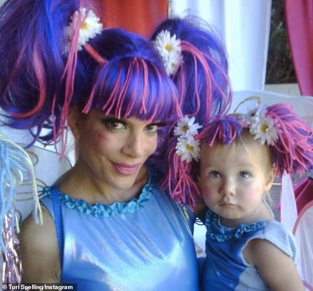 Reminiscing: In one hilarious throwback included in the slew of snaps, Tori and Stella wore matching bright blue outfits with pink yarn pigtails