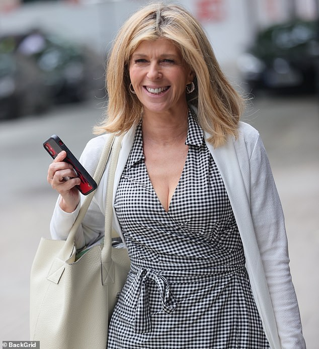 All smiles: Kate Garraway suffered a morning of blunder on Friday as various times on GMB seemed to go wrong - but she avoided her woes later in the day