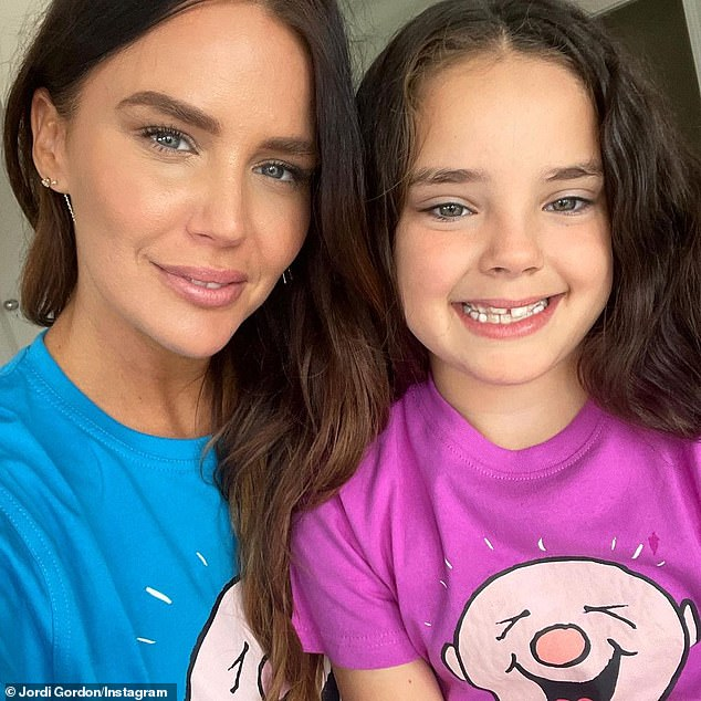 Sweet: Jodi Gordon has shared a series of cute photos posing alongside her look-alike daughter Aleeia, seven.  The former Neighbors star, 36, shared the images on Instagram on Friday.  Both in the photo