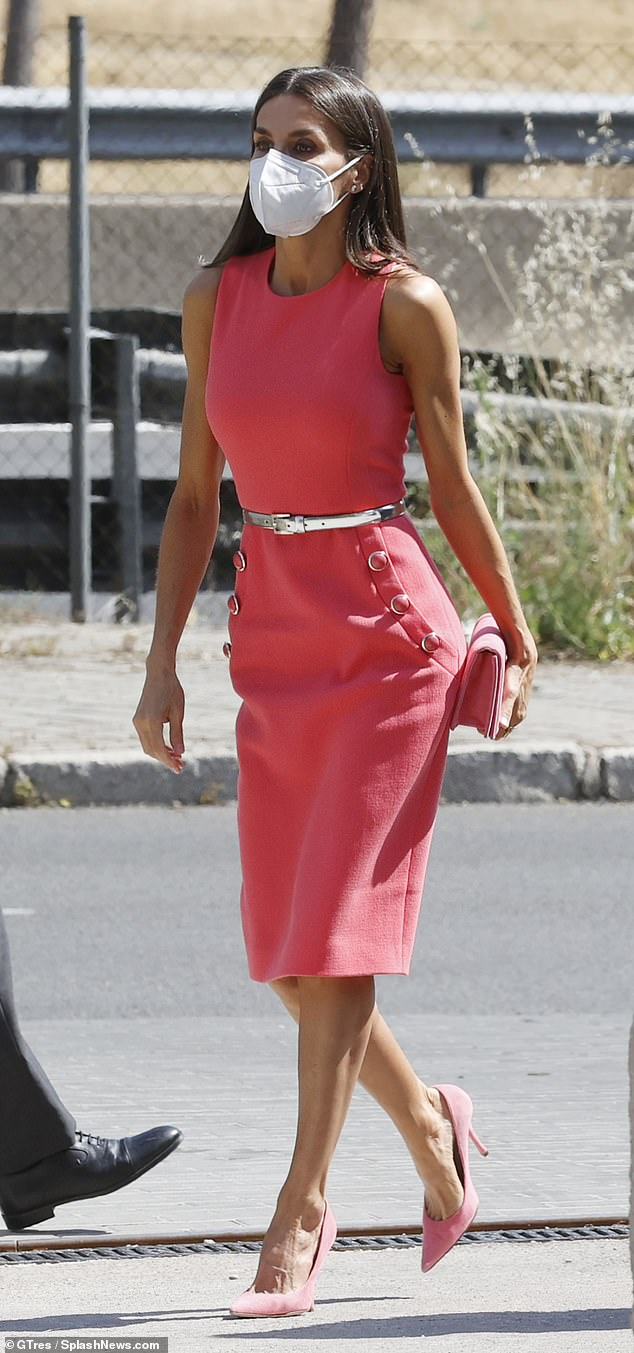 The Spanish royal looked typically polished as she attended the Women Now summit in the country's capital city wearing an embellished, wool-blend midi dress in bubblegum pink